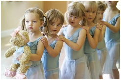 Photo of nursery aged dancers in a line with Melody Bear leading