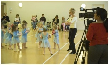 Photo of Jill Bridger and Melody Movement dancers being filmed for ITV news