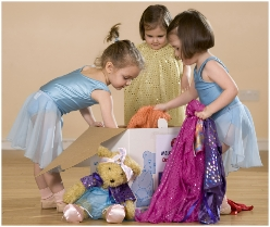 Photo of dancers with a dressing-up box